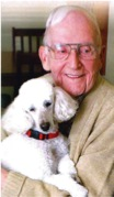 Don, Deb's step-dad, at Village House Hospice with a therapy dog